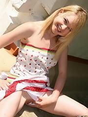 Naughty blonde teen pleasures herself outside