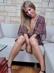 Gorgeous blonde pulls down her pink panties