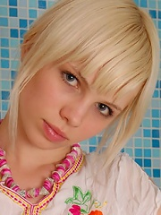 Blonde stripping in a bathroom