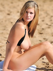 Danielle gets naughty at the beach
